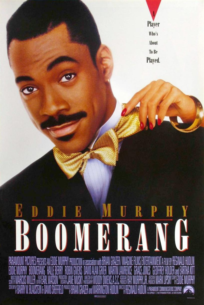 "Boomerang movie poster featuring Eddie Murphy wearing a tux and a female hand reaching over his left shoulder pulling at his tie. Above the hand are the words ""A Player Who's About To Be Player."""