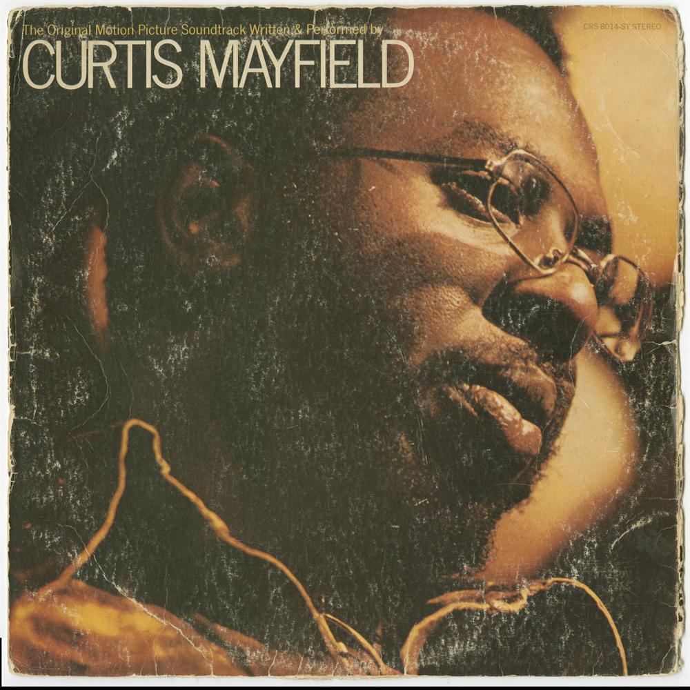 Photo of a warn Curtis Mayfield LP album cover.