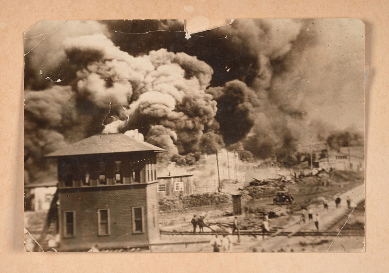 Photograph of the Greenwood District burning during the Tulsa Race Massacre