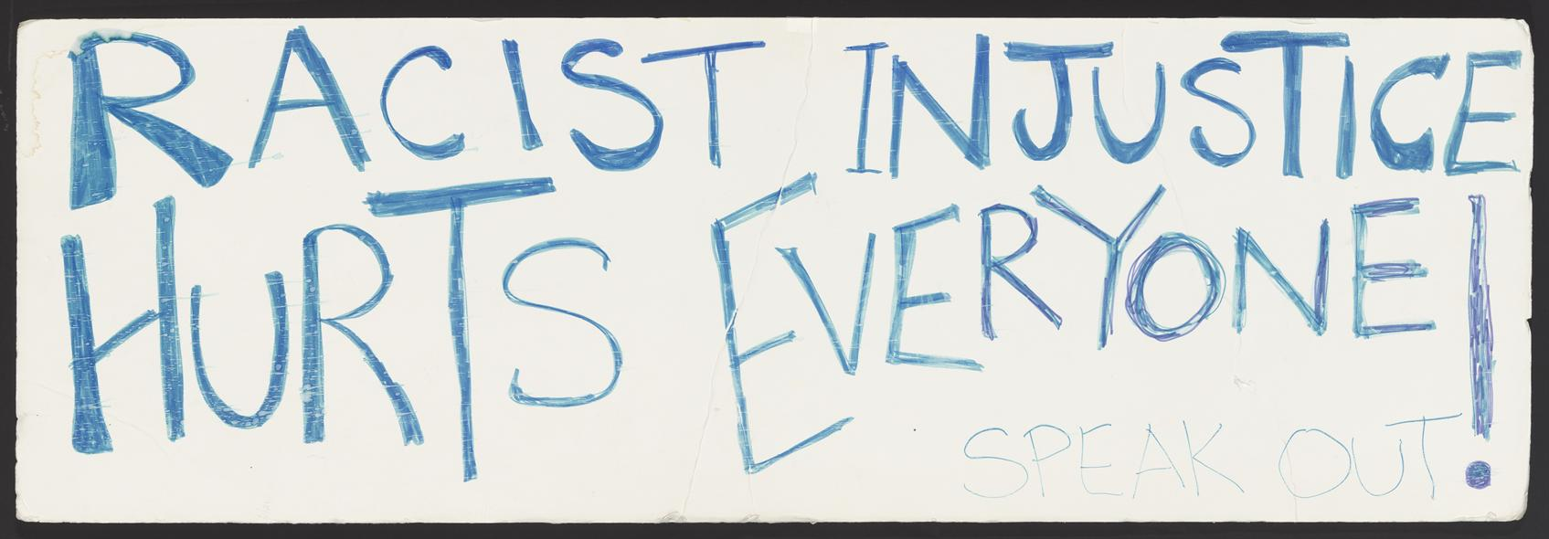 """photo of hand drawn side with the phrase """"Racist Justice Hurts Everyone Speak Out!"""