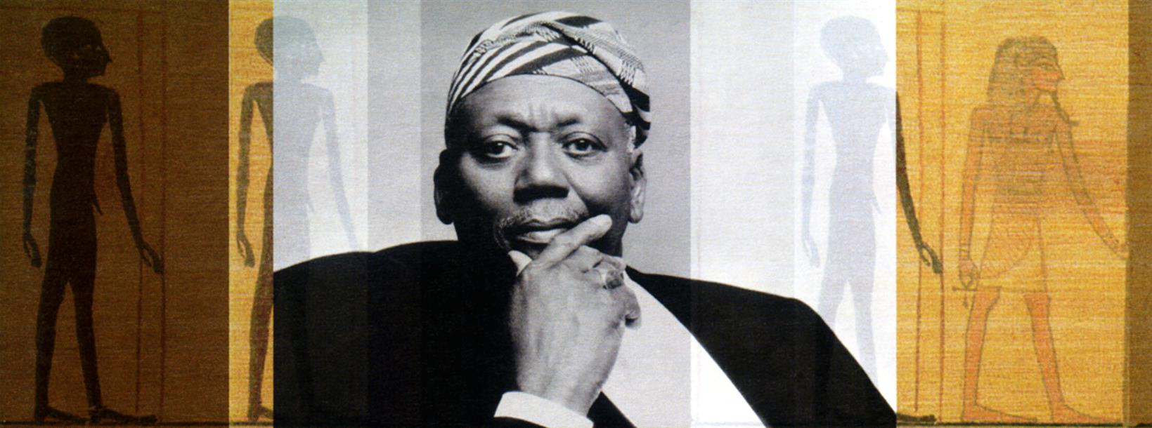 Portrait photo of Randy Weston with his right hand on his chin.