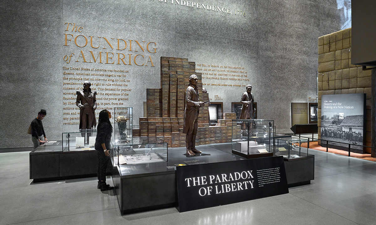 The Paradox of Liberty section of Slavery and Freedom featuring bronze statues of famous figures at the founding of America.